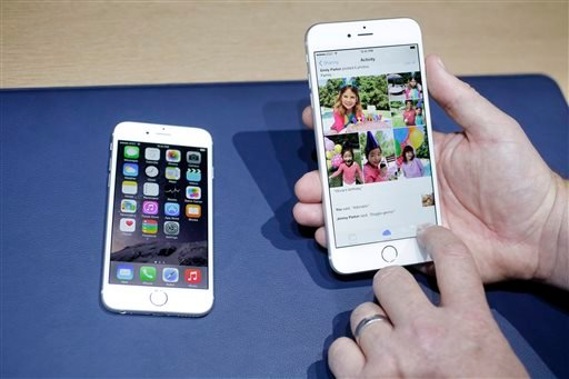 In this Tuesday, Sept. 9, 2014, file photo, the iPhone 6, at left, and iPhone 6 plus are shown next to each other during a new product release in Cupertino, Calif.