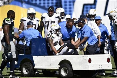 San Diego Chargers running back Ryan Mathews is carted off the field after being injured during the second half of an NFL football game against the Seattle Seahawks, Sunday, Sept. 14, 2014, in San Diego.