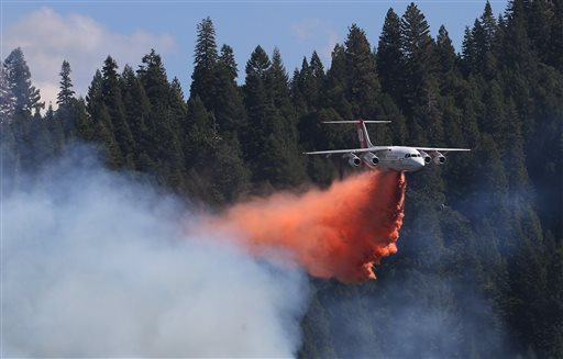 A jet aerial tanker drops its load of fire retardant on a fire near Pollack Pines, Calif., Monday, Sept. 15, 2014.