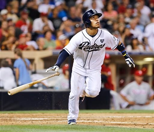 San Diego Padres' Alexi Amarista watches as his two-run home run head for the right field seats against the Philadelphia Phillies during the sixth inning of a baseball game Tuesday, Sept. 16, 2014, in San Diego. (AP Photo/Don Boomer)