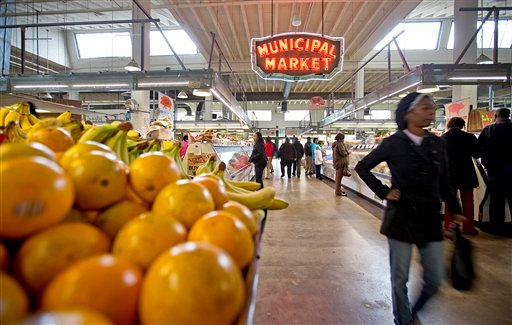 FILE - This Dec. 20, 2013, file photo shows shoppers passing through the Sweet Auburn Curb Market in Atlanta. (AP Photo/David Goldman, File)