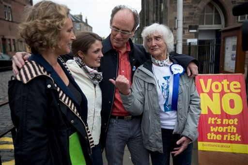 Independence referendum Yes supporter Edinburgh resident Isabelle Smith, right with her family members, from left, her niece Lynn Wilson, granddaughter Jean Thomae and son John Smith in Edinburgh, Sept. 18, 2014. (AP Photo/Matt Dunham)