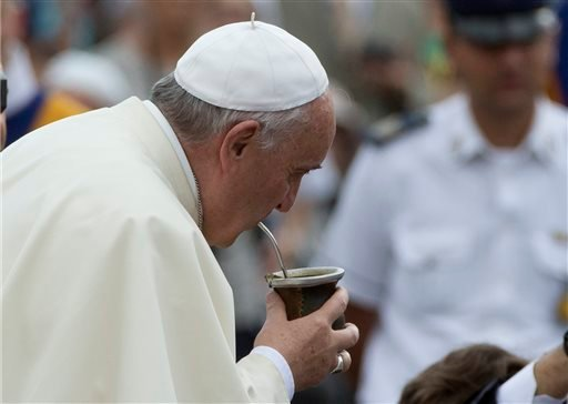 Pope Francis drinks from a mate gourd, a traditional South American cup, he was offered as he arrived for his weekly general audience, in St. Peter's Square, at the Vatican, Wednesday, Sept. 17, 2014. (AP Photo/Andrew Medichini)