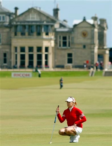 In this Aug. 4, 2007, file photo, Natalie Gulbis of the United States, lines up a putt on the 17th green during the Women's British Open golf tournament on the Old Course at the Royal and Ancient Golf Club in St Andrews, Scotland.