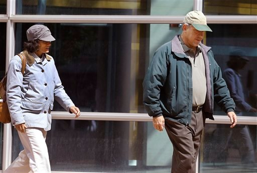 In this Sept. 10, 2014 photo, Ana and John Conley, parents of defendant Shannon Conley, exit the U.S. Federal courthouse following their daughter's plea hearing, at the U.S. Federal Courthouse, in Denver.