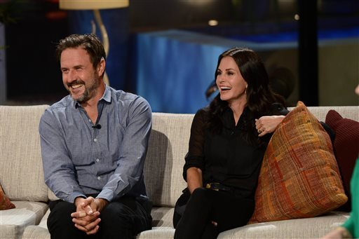 "This undated photo provided by FremantleMedia North America & Debmar-Mercury shows producers, David Arquette, left, and Courtney Cox, on their show, ""Celebrity Name Game,"" hosted by Craig Ferguson."