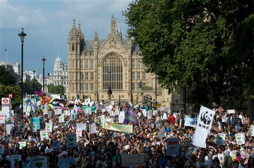 The People's Climate March passes the Houses of Parliament, central London, Sunday, Sept. 21, 2014.