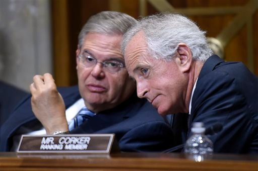 In this July 29, 2014, file photo, Senate Foreign Relations Committee Chairman Sen. Robert Menendez, left, D-N.J., talks with ranking member Sen. Bob Corker, R-Tenn., on Capitol Hill in Washington.