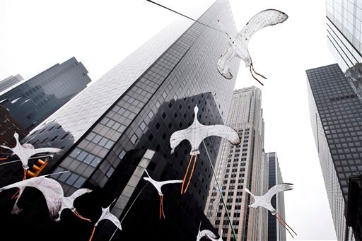 Bird-shaped kites are held in the air as demonstrators make their way down Sixth Avenue during the People's Climate March, Sunday, Sept. 21, 2014, in New York.