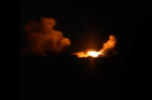 This image made from amateur video posted on an activist social media account early Tuesday, Sept. 23, 2014, which has been verified and is consistent with other AP reporting, shows an explosion in the village of Kfar Derian, Syria.