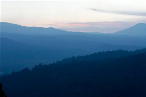 Smoke hovers over the Plumas National Forest west of Clio, Calif., on Monday, Sept. 22, 2014.