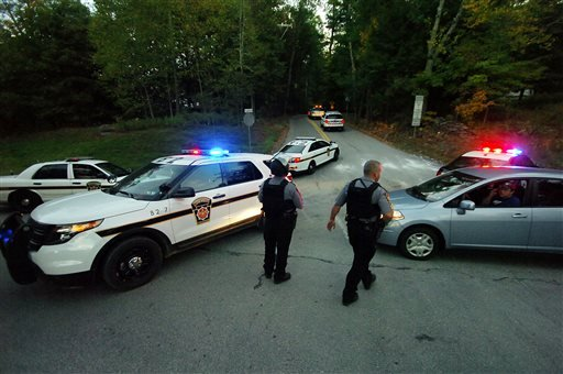Police State Police vehicles speed up Snow Hill Road on Route 447 in Price Township on Sunday, Sept. 21, 2014, near Canadensis, Pa., Both roads were closed for several hours during the massive search for suspected killer Eric Frein.