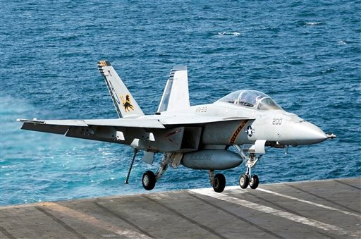 In this image provided by the U.S. Navy a F/A-18F Super Hornet attached to the Fighting Black Lions of Strike Fighter Squadron lands aboard the aircraft carrier USS George H.W. Bush in the Persian Gulf on Tuesday, Sept. 23, 2014. (AP)