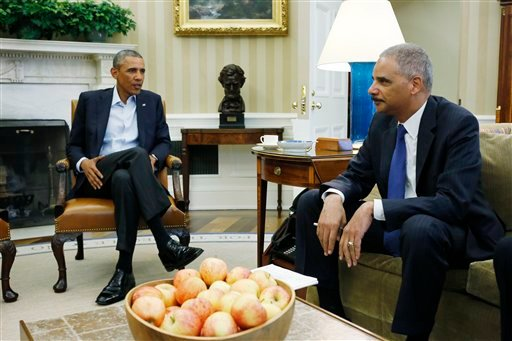 Aug. 18, 2014 file photo: President Barack Obama meets with Attorney General Eric Holder regarding the fatal police shooting of Michael Brown in Ferguson, Missouri, in the Oval Office at the White House. (AP Photo/Charles Dharapak, File)