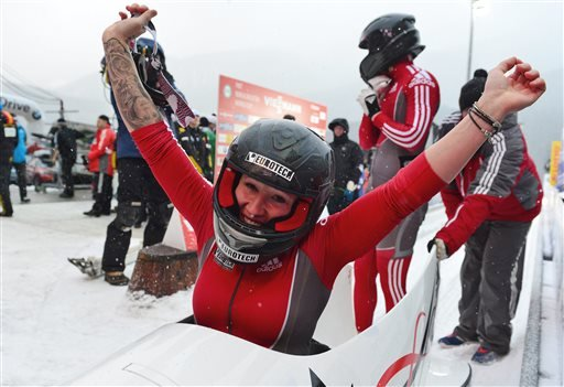 In this Jan. 11, 2013, file photo, Canada's Kaillie Humphries reacts in front of teammate Chelsea Valois in the finish area after the two-women bob race at the Bob World Cup in Koenigssee, Germany.