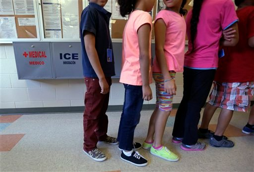FILE - In this Sept. 10, 2014 file photo, detained immigrant children line up in the cafeteria at the Karnes County Residential Center, a temporary home for immigrant women and children detained at the border, in Karnes City, Texas. (AP)