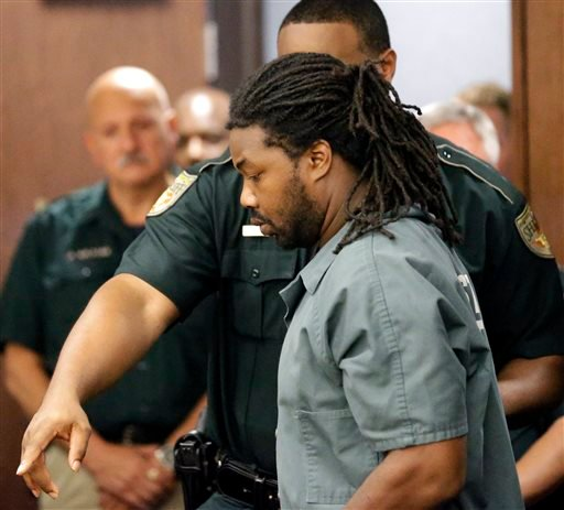Jesse Leroy Matthew Jr. is escorted into a courtroom for an appearance before 405th District Court Judge Michelle Slaughter regarding his extradition back to Virginia, Thursday, Sept. 25, 2014, in Galveston, Texas.