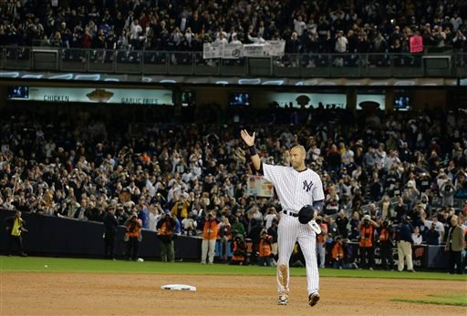 New York Yankees shortstop Derek Jeter waves to fans as he walks around the infield after driving in the winning run against the Baltimore Orioles in the ninth inning of a baseball game, Thursday, Sept. 25, 2014, in New York.