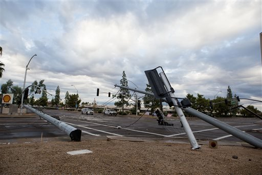Destroyed stop lights sit on the road after the recent storm near 59th Avenue and Greenway Road Saturday, Sept. 27 in Phoenix. (AP Photo/The Arizona Republic, Dominic Valente)