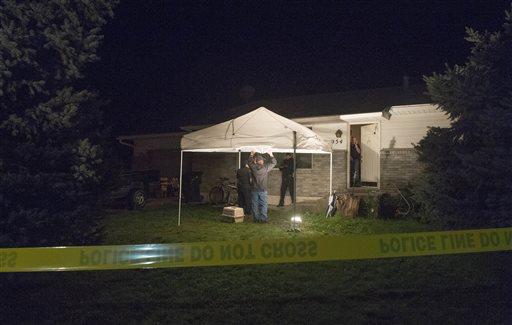 Springville Police investigate the scene where five people were found dead in a home in Springville, Utah, on Saturday, Sept. 27, 2014. (AP Photo/The Salt Lake Tribune, Rick Egan)