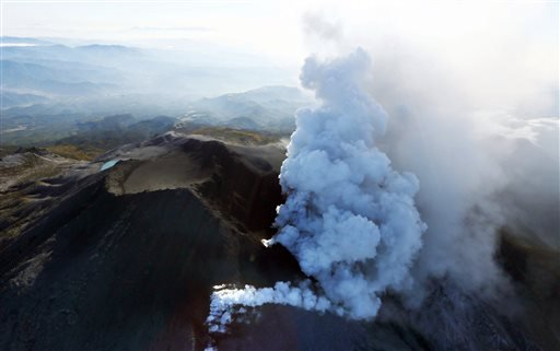 Plumes of smoke and ash billow from Mount Ontake as it continues to erupt in central Japan, Sunday, Sept. 28, 2014.