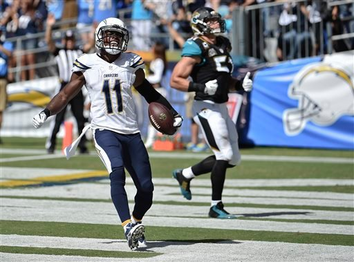San Diego Chargers wide receiver Eddie Royal celebrates his 43-yard touchdown reception against the Jacksonville Jaguars during the first half of an NFL football game Sunday, Sept. 28, 2014, in San Diego. (AP Photo/Denis Poroy)