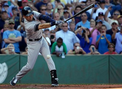 New York Yankees designated hitter Derek Jeter gets an infield hit against the Boston Red Sox, driving in Ichiro Suzuki, during the third inning of a baseball game Sunday, Sept. 28, 2014, at Fenway Park in Boston.