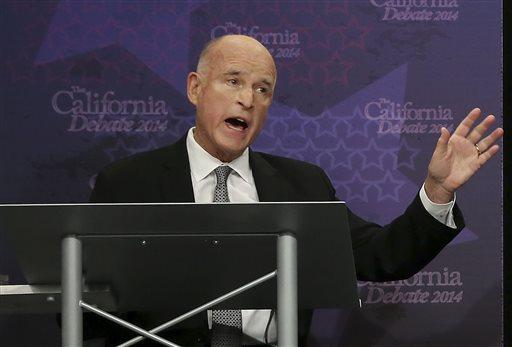 In this Sept. 4, 2014, file photo, Gov. Jerry Brown speaks during a gubernatorial debate with Republican challenger Neel Kashkari in Sacramento, Calif.