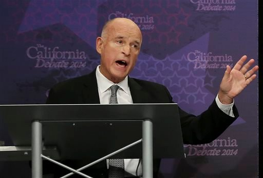 In this Sept. 4, 2014, file photo, Gov. Jerry Brown speaks during a gubernatorial debate with Republican challenger Neel Kashkari in Sacramento, Calif.