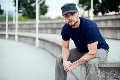 In this Wednesday, Sept. 17, 2014 photo, Brandon Bryant, 28, poses for a photo, in Caras Park in Missoula, Mont.