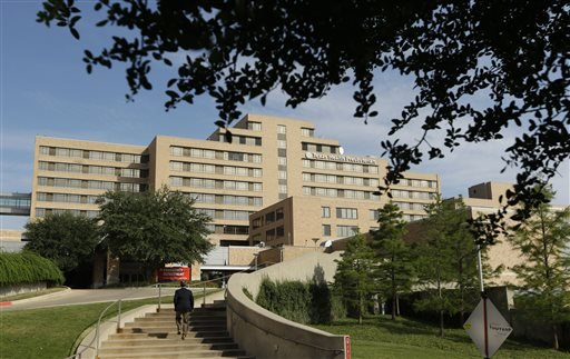 A man walks up the stairway leading to the Texas Health Presbyterian Hospital in Dallas, Tuesday, Sept. 30, 2014.