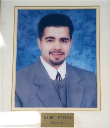 An official portrait of Daniel Crespo, the mayor of the City of Bell Gardens hangs at the city's police station in Bell Gardens, Calif., Tuesday, Sept. 30, 2014. (AP)