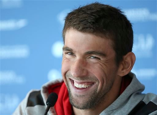 FILE - In this Aug. 20, 2014, file photo, U.S. swimmer Michael Phelps laughs during a press conference ahead of the Pan Pacific swimming championships in Gold Coast, Australia. (AP)