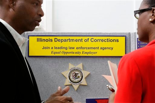In this Sept. 25, 2014 photo, Illinois Department of Corrections employment recruiter, Forrest Ashby, left, speaks to students attending The Foot in the Door Career Fair at the University of Illinois in Springfield, Ill.