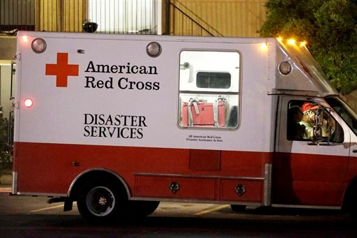 Red Cross representatives depart The Ivy Apartments after dropping off supplies to residents in one of the units at the complex, Thursday, Oct. 2, 2014, in Dallas.