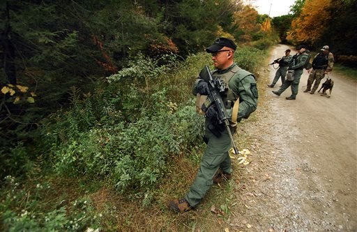 A member of the Scranton, Pa., Police Special Operations Group, prepares to ender the woods, Thursday, Oct. 2, 2014, in Barrett Township near Canadensis, Pa., to search for suspected killer Eric Frein. (AP)
