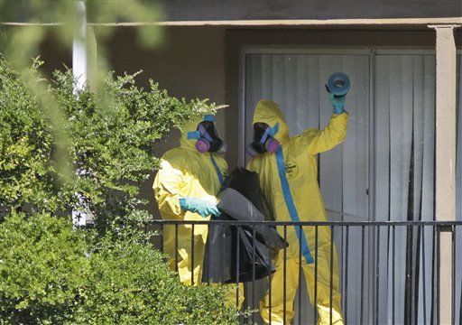 Hazardous material cleaners arrives at the apartment complex in Dallas, Friday, Oct. 3, 2014, where Thomas Eric Duncan, the Ebola patient who traveled from Liberia to Dallas stayed last week.