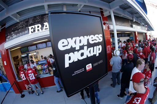 In this Sept. 14, 2014 photo, fans wait in an express pickup line at a Levi's Stadium concessions stand during an NFL football game between the San Francisco 49ers and the Chicago Bears in Santa Clara, Calif.