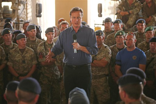 Britain's Prime Minister David Cameron, centre, addresses British troops, in Camp Bastion, Afghanistan, Friday, Oct. 3, 2014.