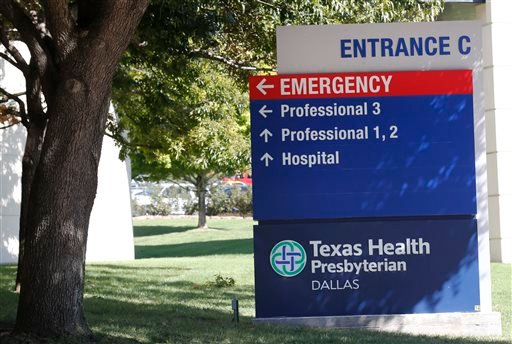 A sign marks Entrance C at Texas Health Presbyterian Hospital Friday, Oct. 3, 2014, in Dallas, where Thomas Eric Duncan, the Ebola patient who traveled from Liberia to Dallas last week, is being treated. (AP Photo/The Dallas Morning News, David Woo)
