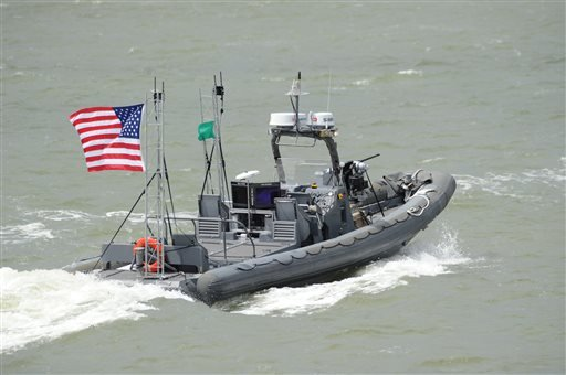 This Tuesday Aug. 12, 2014 photo provided by the U.S. Navy shows an unmanned 11-meter rigid hulled inflatable boat (RHIB) from Naval Surface Warfare Center Carderock. (AP Photo/U.S. Navy, John F. Williams)