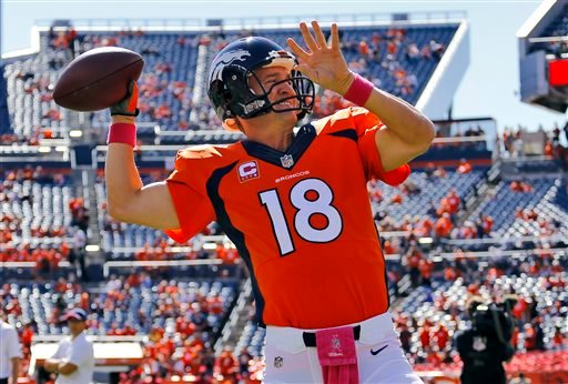 Denver Broncos quarterback Peyton Manning (18) warms up prior to an NFL football game against the Arizona Cardinals, Sunday, Oct. 5, 2014, in Denver. (AP Photo/Jack Dempsey)