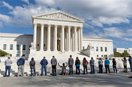 As the Supreme Court begins its new term this week, pro-life advocates hold a prayer vigil on the plaza of the high court in Washington, Saturday, Oct. 4, 2014.