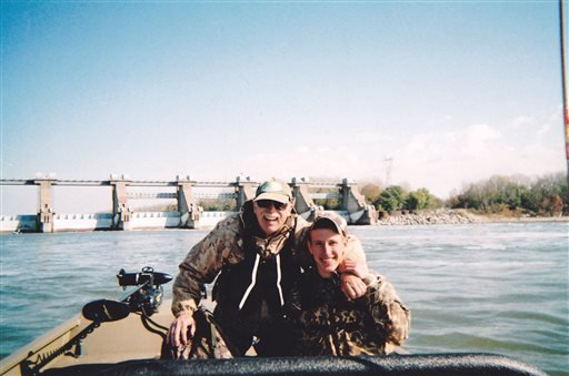 In this 2011 photo provided by the Kassig Family, Abdul-Rahman Kassig, right, poses for a photo while fishing with his father, Ed Kassig, near the Cannelton Dam on the Ohio River in southern Indiana.