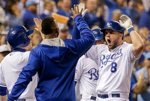 Kansas City Royals' Mike Moustakas (8) celebrates his two-run home run against the Los Angeles Angels during the fourth inning of Game 3 of baseball's AL Division Series in Kansas City, Mo., Sunday, Oct. 5, 2014. (AP Photo/Charlie Riedel)