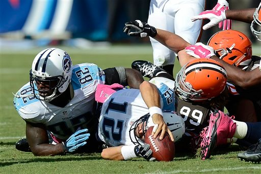 Tennessee Titans quarterback Charlie Whitehurst (12) comes up short as he tries to run for a first down against the Cleveland Browns in the fourth quarter of an NFL football game Sunday, Oct. 5, 2014, in Nashville, Tenn.