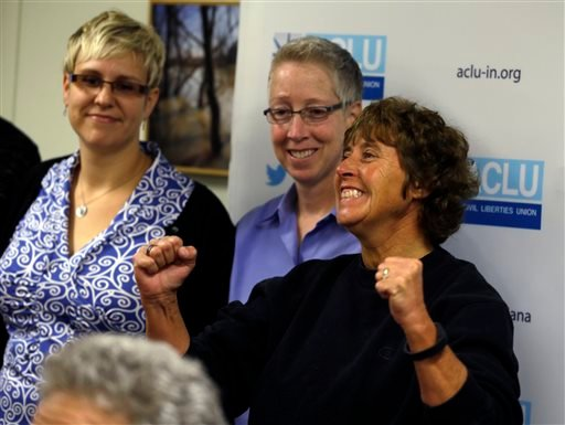 Teresa Welborn, right, cheers at an ACLU news conference in Indianapolis Oct. 6, 2014, after it was announced that the U.S. Supreme Court turned away appeals from Indiana and 4 other states seeking to prohibit same-sex marriages. (AP Photo/Michael Conroy)