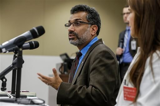 Dr. Ali Khan, Dean of the College of Public Health at the Nebraska Medical Center, speaks during a news conference in Omaha, Neb., Friday, Oct. 3, 2014, to discuss Ebola patient, journalist Ashoka Mukpo.