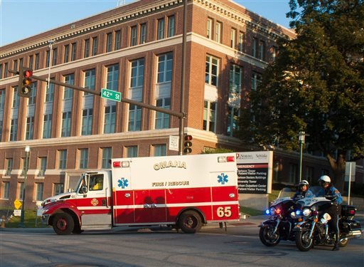 An ambulance transports Ashoka Mukpo, who contracted Ebola while working in Liberia, to the Nebraska Medical Center's specialized isolation unit Oct. 6, 2014, in Omaha, Neb., where he will be treated for the deadly disease. (AP Photo/Dave Weaver)