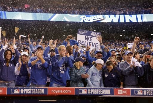 Fans celebrate after the Kansas City Royals won Game 3 of baseball's AL Division Series against the Los Angeles Angels Sunday, Oct. 5, 2014, in Kansas City, Mo. The Royals won 8-3 to sweep the Angels in the series. (AP Photo/Charlie Riedel)